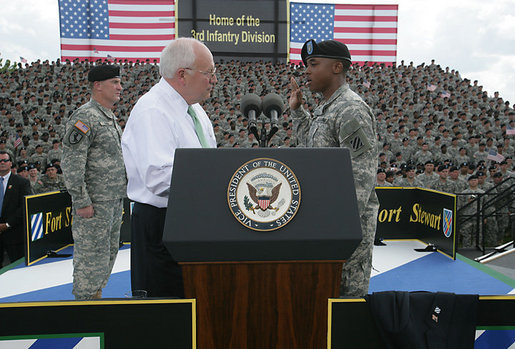 Vice President Dick Cheney administers the Ceremonial Oath of Re-enlistment of Corporal Jarrod Fields, at a rally for the troops at Fort Stewart, Ga., Friday, July 21, 2006. Cpl. Fields was wounded by an improvised explosive device in 2005 while serving in Iraq with the 3rd Infantry Division. White House photo by David Bohrer
