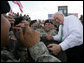 Vice President Dick Cheney shakes hands and poses for photographs with soldiers from the Army's 3rd Infantry Division during a rally at Fort Stewart, Ga., Friday, July 21, 2006. White House photo by David Bohrer