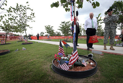 "Vice President Dick Cheney tours the ""Warriors Walk,"" a living memorial of Eastern Redbud trees dedicated to the fallen soldiers assigned to the 3rd Infantry Division who served in Operation Iraqi Freedom, as part of his visit to Fort Stewart, Ga., Friday, July 21, 2006. White House photo by David Bohrer"