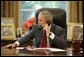 President George W. Bush offers his congratulations to Tour de France winner Floyd Landis during a phone call from the Oval Office, Sunday, July 23, 2006. White House photo by Kimberlee Hewitt