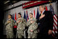 President George W. Bush recites the Pledge of Allegiance Monday, July 24, 2006, at Walter Reed Army Medical Center in Washington, D.C., joining newly sworn-in American citizens, Specialist Sergio Lopez, 24, of Bolingbrook, Ill., left, Specialist Noe Santos-Dilone of Brooklyn, N.Y., center, and Private First Class Eduardo Leal-Cardenas of Los Angeles, Calif., during their naturalization ceremony. White House photo by Eric Draper