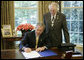 President George W. Bush is joined by U.S. Rep. Roscoe Bartlett, R- Md., as he signs H.R. 42, Freedom to Display the American Flag Act of 2005, Monday, July 24, 2006, in the Oval Office of the White House. The bill prevents a condominium association, cooperative association, or residential real estate management association from denying an owner or resident from displaying the U.S. flag on their residential property within the association. White House photo by Paul Morse