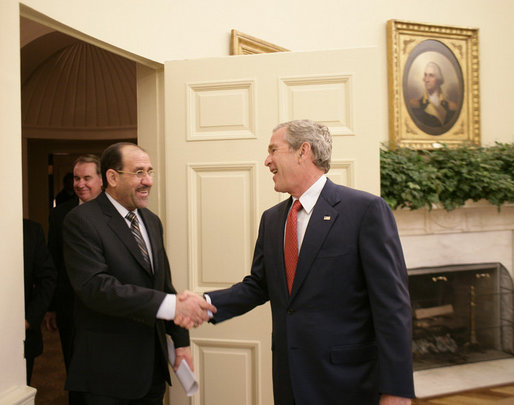 President George W. Bush welcomes Iraqi Prime Minister Nouri al-Maliki into the Oval Office of the White House Tuesday, July 25, 2006, where the two leaders talked about plans to expand the security presence in the neighborhoods of the Iraqi capital. White House photo by Eric Draper
