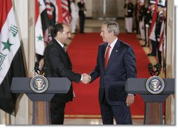 President George W. Bush shakes hands with Iraqi Prime Minister Nouri al-Maliki at the conclusion of their joint press availability in the East Room of the White House Tuesday, July 25, 2006. White House photo by Kimberlee Hewitt