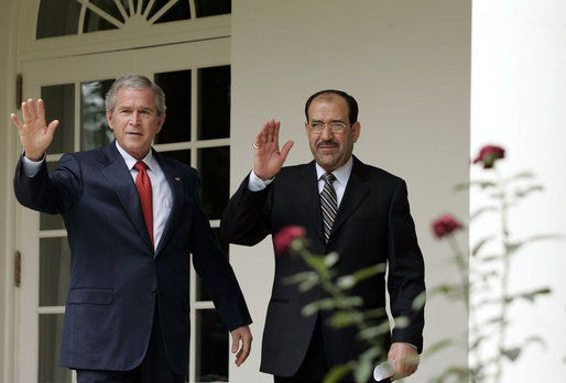 President George W. Bush and Iraqi Prime Minister Nouri al-Maliki walk along the colonnade of the Rose Garden after meeting in the Oval Office Tuesday, July 25, 2006. White House photo by Paul Morse