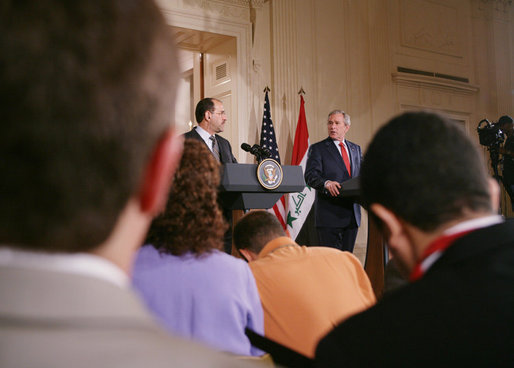 President George W. Bush and Iraqi Prime Minister Nouri al-Maliki take questions from reporters at a joint press availability in the East Room of the White House Tuesday, July 25, 2006, where they answered questions on security in Iraq and the ongoing crisis in Lebanon. White House photo by David Bohrer
