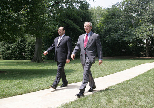 President George W. Bush and Iraqi Prime Minister Nouri al-Maliki walk from the Oval Office toward the South Lawn of the White House Wednesday, July 26, 2006, to board Marine One for their trip to Fort Belvoir, Va., to meet military personnel and families. White House photo by David Bohrer