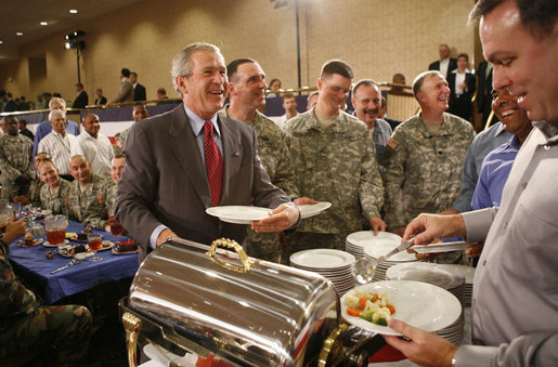 President George W. Bush speaks with military personnel as he makes his way along a buffet line during a visit to Fort Belvoir, Va., Wednesday, July 26, 2006. White House photo by Paul Morse