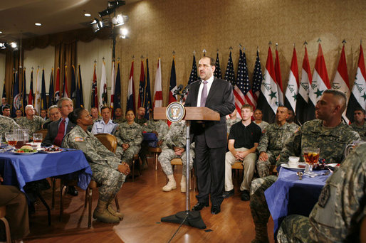 President George W. Bush listens as Iraqi Prime Minister Nouri al-Maliki speaks to military personnel and their families during his visit to Fort Belvoir, Va., Wednesday, July 26, 2006. White House photo by Paul Morse
