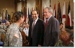 President George W. Bush and Iraqi Prime Minister Nouri al-Maliki meet with military personnel during their visit to Fort Belvoir, Va., Wednesday, July 26, 2006.  White House photo by Paul Morse
