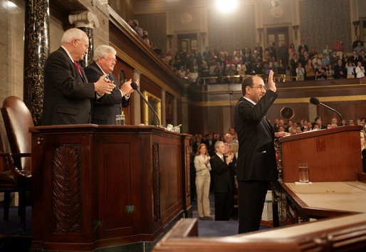 Prime Minister of Iraq Nouri al-Maliki responds to a welcome from Vice President Dick Cheney, House Speaker Dennis Hastert, and Congressional members before addressing a Joint Meeting of Congress, Wednesday, July 26, 2006, at the U.S. Capitol in Washington, D.C. Prime Minister Maliki, the first democratically elected prime minister of Iraq since the fall of Saddam Hussein, is on his first visit to Washington and met with President Bush yesterday to discuss the future development and security of Iraq. White House photo by David Bohrer