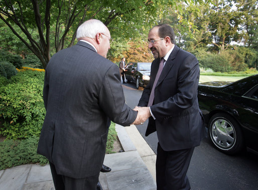 Vice President Dick Cheney welcomes Prime Minister of Iraq Nouri al-Maliki to the Vice President's residence at the U.S. Naval Observatory in Washington, D.C. for a dinner, Wednesday, July 26, 2006. Earlier in the day Prime Minister Maliki addressed a Joint Meeting of Congress and accompanied President George W. Bush in meeting with U.S. military personnel at Fort Belvoir, Va. White House photo by David Bohrer