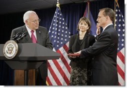 Vice President Dick Cheney swears in Steven Preston as the Administrator of the Small Business Administration during a ceremony at the Offices of the Small Business Administration in Washington, D.C., Wednesday, July 26, 2006. Preston's wife, Molly, holds the Bible. White House photo by Kimberlee Hewitt