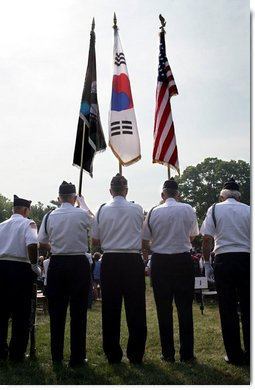 An honor guard composed of Korean War veterans holds flags prior to the start of the 2006 Korean War Veterans Armistice Day Ceremony held at the Korean War Memorial on the National Mall in Washington, D.C., Thursday, July 27, 2006. White House photo by David Bohrer