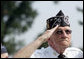 A Korean War veteran salutes during the singing of the National Anthem, Thursday, July 27, 2006 during the 2006 Korean War Veterans Armistice Day Ceremony held at the Korean War Memorial in Washington, D.C. Vice President Dick Cheney honored the veterans in an address and remembered fallen soldiers in a wreath laying ceremony at the memorial. White House photo by David Bohrer