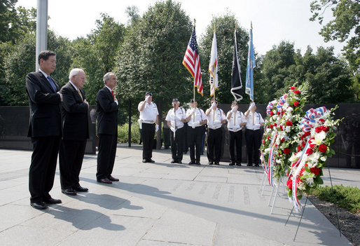Vice President Dick Cheney stands with Secretary of the Interior Dirk Kempthorne, right, and South Korean Ambassador to the U.S. Tae Sik Lee, left, during a moment of silence after placing a wreath at the Korean War Memorial in Washington, D.C. to commemorate Korean War Veterans Armistice Day, Thursday, July 27, 2006. Today marks the 53rd anniversary of the end of the Korean War. White House photo by David Bohrer