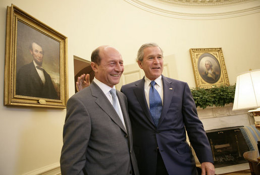 President George W. Bush welcomes Romanian President Traian Basescu to the Oval Office at the White House Thursday, July 27, 2006 in Washington, D.C. White House photo by Eric Draper