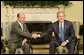 "President George W. Bush meets with Romanian President Traian Basescu in the Oval Office Thursday, July 27, 2006. ""Romania will continue to remain an ally of the United States in supporting the democracy in Iraq and Afghanistan, in supporting democratic regimes in these countries like a key of freedom on the area,"" said President Basescu during the two leaders' remarks to the press. White House photo by Eric Draper"