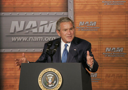 President George W. Bush gestures as he addresses the National Association of Manufacturers on the strength of the U.S. economy Thursday, July 27, 2006, at the Grand Hyatt hotel in Washington, D.C. White House photo by Paul Morse