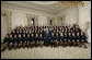 President George W. Bush poses with members of the National FFA Organization State Presidents' Conference Thursday, July 27, 2006, in the State Dining Room of the White House. The National FFA is a youth organization founded in 1928 that prepares high school students for leadership, personal growth and successful careers through agricultural education. White House photo by Eric Draper
