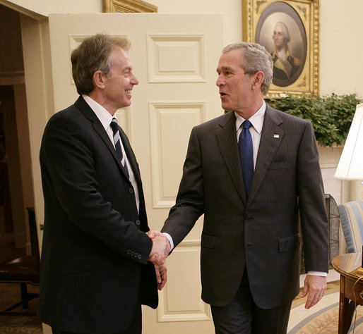 President George W. Bush welcomes Prime Minister Tony Blair of the United Kingdom back to the White House where the two leaders met for private discussions and later held a joint press availability Friday, July 28, 2006, in the East Room of the White House. White House photo by Eric Draper