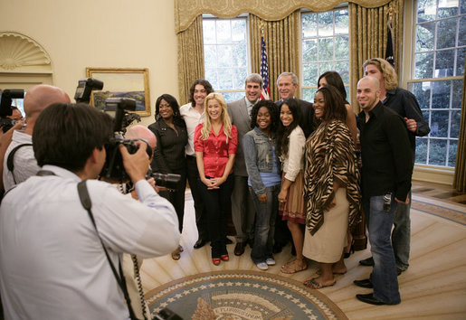 "President George W. Bush welcomes nine of the top 10 American Idol finalists to the Oval Office at the White House Friday, July 28, 2006. The popular FOX television program, which originated in 2002, uses audience participation to determine the best ""undiscovered"" young singer in the nation. Top row from left to right are Jamecia Bennett, mother of performer Paris Bennett, Ace Young, American Idol winner Taylor Hicks, Katherine McPhee, Bucky Covington, bottom row from left to right, Kellie Pickler, Paris Bennett, Lisa Tucker, Mandisa Hundley and Chris Daughtry. White House photo by Eric Draper"