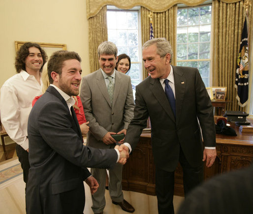 "President George W. Bush welcomes Elliott Yamin, one of the top 10 American Idol finalists who arrived late to the Oval Office at the White House Friday, July 28, 2006, along with Yamin's fellow performers, from left to right, Ace Young, Kelli Pickler, American Idol winner Taylor Hicks and Katharine McPhee. The popular FOX television program, which originated in 2002, uses audience participation to determine the best ""undiscovered"" young singer in the nation. White House photo by Eric Draper"