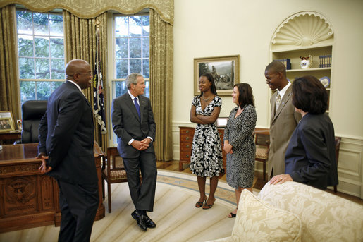 President George W. Bush meets with the Big Brother and Big Sister of the Year in the Oval Office Friday, July 28, 2006. From left, they are: Big Brother of the Year Sylvester Fulton of Memphis, Tenn.; LaMecca Butler, Betsy's little sister; Big Sister of the Year Betsy Gorman-Bernardi of Albany, N.Y.; Jeremy Moore, Sylvester's little brother; and President and CEO Judy Vredenburgh of BBBS of America. White House photo by Paul Morse
