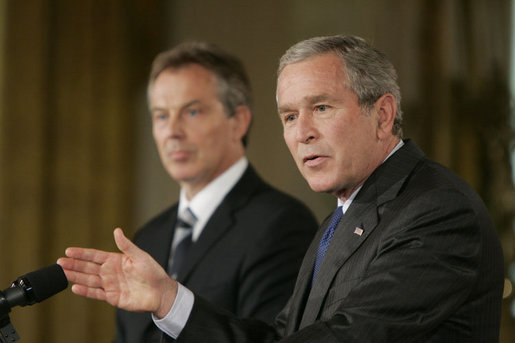 President George W. Bush gestures as he answers a reporter's question during a joint press availability with Prime Minister Tony Blair of the United Kingdom Friday, July 28, 2006, in the East Room of the White House. White House photo by Paul Morse