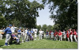 President George W. Bush welcomes players and guests to the White House Sunday, July 30, 2006, for the Tee Ball on the South Lawn game between the Thurmont Little League Civitan Club of Frederick Challengers of Thurmont, Md., and the Shady Spring Little League Challenger Braves of Shady Spring, W. Va. White House photo by Paul Morse
