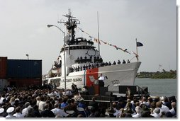 "President George W. Bush discusses America's economy at the U.S. Coast Guard Integrated Support Command at the Port of Miami Monday, July 31, 2006. ""It's an honor to be here at the largest container port in Florida and one of the most important ports in our nation,"" said President Bush. ""From these docks, ships loaded with cargo deliver products all around the world carrying that label ""Made in the USA.""' White House photo by Kimberlee Hewitt"