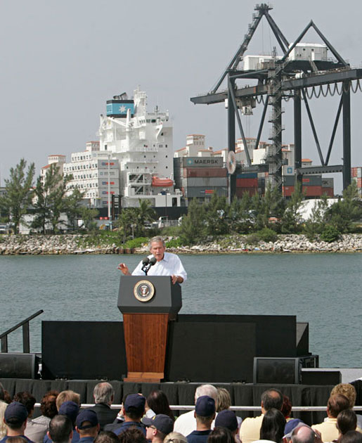 "President George W. Bush addresses an audience on America's economy at the U.S. Coast Guard Integrated Support Command at the Port of Miami Monday, July 31, 2006. ""It's an honor to be here at the largest container port in Florida and one of the most important ports in our nation,"" said President Bush. ""From these docks, ships loaded with cargo deliver products all around the world carrying that label ""Made in the USA.""' White House photo by Kimberlee Hewitt"