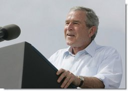 "President George W. Bush discusses America's economy at the U.S. Coast Guard Integrated Support Command at the Port of Miami Monday, July 31, 2006. ""It's an honor to be here at the largest container port in Florida and one of the most important ports in our nation,"" said President Bush.  White House photo by Kimberlee Hewitt"