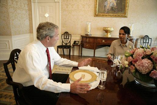 President George W. Bush meets with U.S. Secretary of State Condoleezza Rice at the White House Monday evening, July 31, 2006, to discuss her recent trip to the Middle East. White House photo by Eric Draper