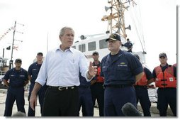 President George W. Bush stands with Admiral Thad Allen, Commandant of the U.S. Coast Guard, as he talks with reporters following his tour of the U.S. Coast Guard Integrated Support Command at the Port of Miami Monday, July 31, 2006.  White House photo by Kimberlee Hewitt