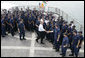 "President George W. Bush meets with the crew of the U.S. Coast Guard vessel ""Valiant"" during his visit to the Integrated Support Command at the Port of Miami Monday, July 31, 2006. White House photo by Kimberlee Hewitt"
