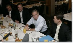 President George W. Bush meets business leaders and his brother, Florida Governor Jeb Bush, left, in Miami at the Versailles Restaurant and Bakery for a breakfast meeting Monday, July 31, 2006. White House photo by Kimberlee Hewitt