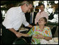 President George W. Bush meets with customers at the Versailles Restaurant and Bakery in Miami following his breakfast meeting with local business leaders Monday, July 31, 2006. White House photo by Kimberlee Hewitt