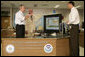President George W. Bush talks with Max Mayfield, center, director of NOAA's Tropical Prediction Center and National Hurricane Center and with Chris Landsea the Science and Operations Officer at the National Hurricane Center in Miami Monday, July 31, 2006. White House photo by Kimberlee Hewitt