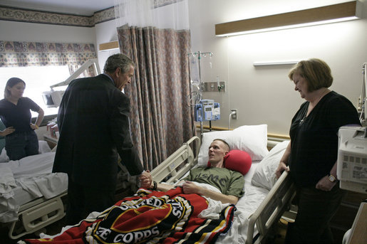President George W. Bush visits U.S. Marine Corps. Maj. James Browning of Natchez, Miss., and his mother, Brenda, at the National Naval Medical Center in Bethesda, Md., Tuesday, Aug. 1, 2006. White House photo by Eric Draper