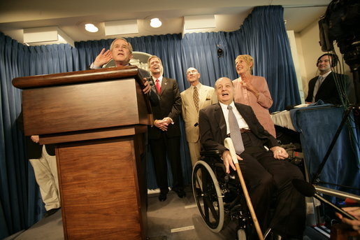 Sharing the stage with several White House Press Secretaries, President George W. Bush jokes with reporters in the James S. Brady Press Briefing Room Wednesday, August 2, 2006. It was the last press briefing before the room undergoes extensive renovations. Pictured at the President's right is Press Secretary James S. Brady, who was wounded during an assassination attempt on President Reagan. The room is named in his honor. White House photo by Eric Draper