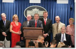 Accompanied by seven White House Press Secretaries, President George W. Bush jokes with reporters Wednesday, August 2, 2006, during the last day of operation of the James S. Brady Press Briefing Room before it undergoes a renovation. On stage with the President are, from left: Joe Lockhart, Dee Dee Myers, Marlin Fitzwater, Tony Snow, Ron Nessen, James Brady and his wife Sarah Brady. White House photo by Shealah Craighead