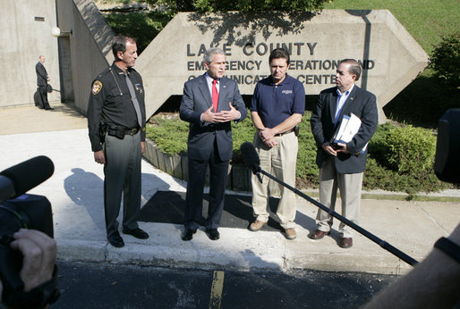 President George W. Bush is joined by Lake County Sheriff Dan Dunlap, left; Larry Greene, director of the Lake County Emergency Management Agency and Jesse Munoz of the Federal Emergency Management Agency, right, as President Bush spoke to reporters Wednesday, Aug. 2, 2006 outside the Lake County Emergency Management Agency facility in Mentor, Ohio, following a meeting on the Lake County flood response following severe storms that caused major flooding in numerous counties in July. White House photo by Kimberlee Hewitt