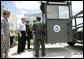 President George W. Bush speaks with members of the National Guard and U.S. Border Patrol officers during his tour along the U.S.-Mexico border Thursday, Aug. 3, 2006, in the Rio Grande Valley border patrol sector in Mission, Texas. White House photo by Eric Draper