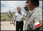President George W. Bush speaks with members of the National Guard on duty along the U.S.-Mexico border during his visit Thursday, Aug. 3, 2006, in the Rio Grande Valley border patrol sector in Mission, Texas. White House photo by Eric Draper