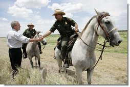 President George W. Bush meets with mounted U.S. Border Patrol agents along the U.S.-Mexico border Thursday, Aug. 3, 2006, in the Rio Grande Valley border patrol sector in Mission, Texas. White House photo by Eric Draper