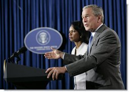 President George W. Bush is joined by Secretary of State Condoleezza Rice as he delivers a statement Monday, Aug. 7, 2006, on the Middle East crisis during a news conference in Crawford, Texas.  White House photo by Eric Draper