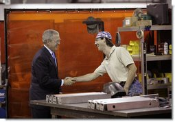 President George W. Bush speaks with a metal worker Thursday, Aug. 10, 2006, during his tour and visit with employees at Fox Valley Metal-Tech in Green Bay, Wis. White House photo by Eric Draper
