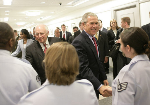 President George W. Bush and Vice President Dick Cheney meet military personnel at the Pentagon following their meeting with U.S. Secretary of Defense Donald Rumsfeld and the Defense Policy and Programs Team, Monday, Aug. 14, 2006, in Arlington, Va. White House photo by Eric Draper