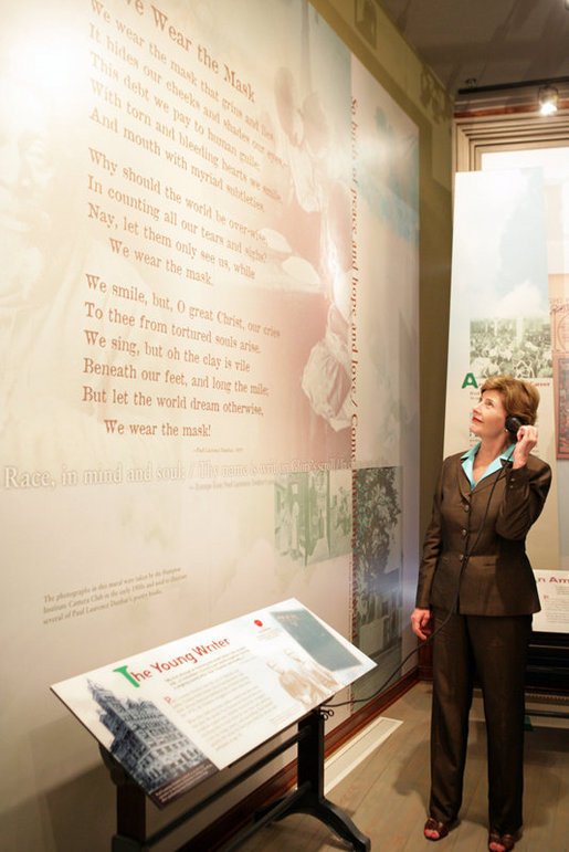 Mrs. Laura Bush listens to a reading of a Paul Laurence Dunbar poem during a tour of the Wright-Dunbar Village, a Preserve America neighborhood, in Dayton, Ohio, Wednesday, August 16, 2006. Paul Laurence Dunbar published a newspaper for the African American community, which the Wright Brothers printed for him in their printing shop. White House photo by Shealah Craighead
